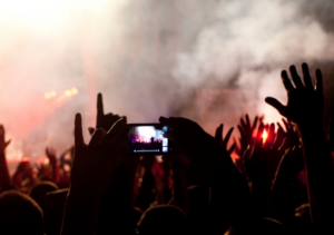 Modern Fan - Festival Shot. - smartphone risks at UK music festivals this summer