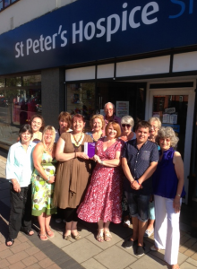Mandi Gibbs is presented with her award by Janet Loud, head of shops
