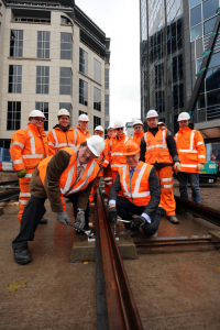Cllr Roger Horton, left, and Steve Davies, Balfour Beatty managing director for the West Midlands - First tracks laid for Midland Metro extension in Birmingham...