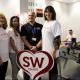 SW Heart Fundraiser Sue Lumley, Uniformed Public Services student Pam Ghatoray, Uniformed Public Services Lecturer Steven Wadley and SW Heart Fundraising Manager and Daily Mail columnist Sally Bee supporting students on their mammoth 24 hour Rowing Machine Challenge.