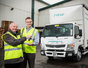 HTA Group's Mark Vale, right,  -  Jim Coton, of Midlands Truck & Van - Canter test drive pays off for prize draw winner HTA Group...