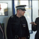 Mark Babington, left, and Insp Lee Gordon meet Home Secretary Theresa May MP at Halesowen bus station.