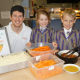 Holy Trinity chef Simon Quill with six-year olds Charlotte Cummings and Sam Austin.
