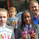 Year 7 pupils Paige Doyle, left, Luke Thrupp, and Dejanique Clarke, all aged 11, of John Wilmott School in Sutton Coldfield, with PCSO Terry Court of the Safer Travel Team.