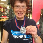 Claudia O'Farrell showing off her medal after taking part in the Bupa Great Birmingham Run.
