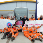 The newly-expanded Midland Metro depot gets the thumbs up from Cllr Roger Horton, left, and Cllr Darren Cooper with workers at the site.