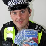 Acting Sergeant Shaun Hickinbottom with the leaflets and anti- theft devices.