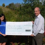 Lucy Leeming, Regional Fundraising Manager at Make-A-Wish UK, receives the cheque from Briggs Equipment's Chief Financial Officer, Peter Jones.