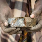 A Fairtrade gold miner in Tanzania holds a piece of ore, from which gold is extracted. (Image: Andy Pilsbury)