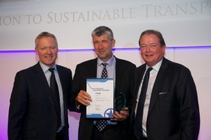 Centro's Head of Sustainability Conrad Jones (centre) accepted the award from host Rory Bremner (l) and Phil Wilbraham (r), of sponsors Heathrow Airport Ltd.