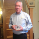 Bill Graham, Chairman of Alloy Wire International, with his Top 100 award from the Manufacturer