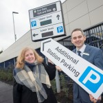 Cllr Kath Hartley and London Midland's Dave Whitley point commuters to extra Park & Ride space at Four Oaks.