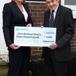 QualitySolicitors Talbots' Mary Mocklow presents Chris Westwood with a cheque for £11,000 raised in memory of Martyn Morgan