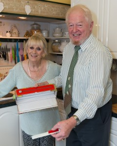 L to R: Showing how to use his cling film dispenser and handy gripper device, serial entrepreneur Tom Elliott and his wife Lynne.