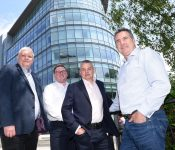 Daniel Oman, Liam Conway, Phil Ager and Chris Ellis (all Control Energy Costs) outside its new Surrey HQ