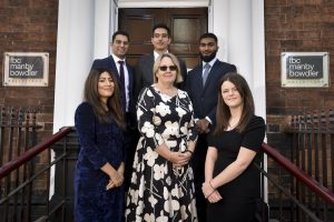 New solicitors and trainees at FBCMB. Bottom Row L to R Ravi Basra, FBCMB Managing Partner, Kim Carr, Megan Price. Back Row L to R Jaspreet Kler, Joseph Martin, Rubel Miah