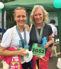 Lucy Wells (right) with Claire Gijselhart from St Richards Hospice - one of the many charities WCF supports