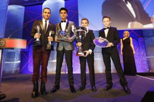 2014 Autosport Awards. Grosvenor House Hotel, Park Lane, London. Sunday 7 December 2014. 2014 Formula One World Champion, Lewis Hamilton with the young karters. World Copyright: Alastair Staley/LAT Photographic. ref: Digital Image _79P1738